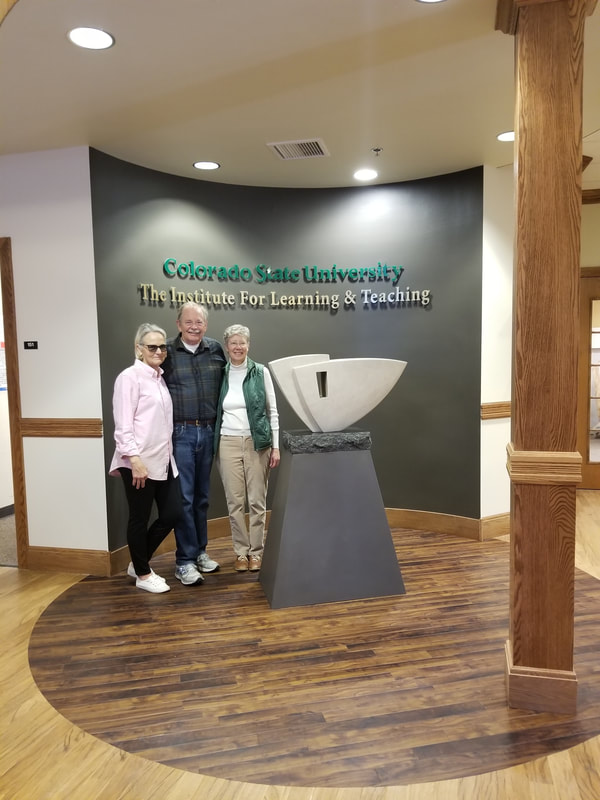 "June 2018: Colorado State University has selected NSG Fellow Kathleen Caricof to create a sculpture honoring Alan Lamborn who retired from a 34-year career with CSU.  In designing the artwork, Caricof worked with the primary theme of the celebration of education, showing the importance of education as a foundation for the future. ​ The selected design, ""Onward"" is a sculpted stone representing the individual whose heart remains open to learning. A carved arrow points in the direction of growth.   NSG Public Art Placement 504"