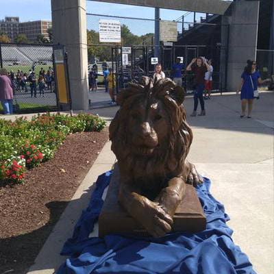 10/22/17: National Sculptors' Guild John Kinkade is in NJ for the unveiling of The College of New Jersey's new Bronze mascot by NSG fellow #HerbMignery. The 8ft Lion served as the official greeter to homecoming fans at the game. The sculpture will be stored until the permanent site at the Brower Student Center is ready in Spring. The sculpture was generously presented to the school by alumnus William McLagan. #GoLions
