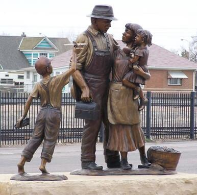 """A Prosperous Past, a Bright Future"" by Fellow Gary Alsum and the National Sculptors' Guild was placed in Brighton, at Bridge St and Cabbage Ave, commissioned through the city of Brighton, Colorado.  ​The public artwork features two sculptural elements. The first element speaks to Brighton's rich history and sense of family. The piece depicts a father, mother and young daughter. The father's occupation is vague so that the viewer could see him as a farmer, a miner or any profession that made Brighton what it is today. On the ground next to the mother's foot is a basket of vegetables, a nod to Brighton's agricultural past and future. The second element connects to the city's current boom and its continued success in the future. This sculpture depicts a young boy, playing with a train and a toy airplane. The train is symbolic of Brighton's past. The airplane is symbolic of Brighton's steady economic growth as a result of its proximity to DIA. Gary states that ""The challenge of sculpture is depicting the movement and energy of a single moment."" Placing a great deal of focus on movement and grace, Gary's sculptures pass on the freedom, joy and curiosity that children display on a daily basis. ​  NSG Public Art Placement #287"