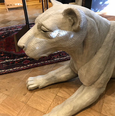 "Update 11/1/18: ​Yes, that's a lioness in the gallery! ​ We have National Sculptors' Guild Fellow Darrell Davis' monumental sculpture here temporarily as we wait for the site and the other two pieces to be cast. We didn't have a stone to anchor her on in the NSG sculpture garden, so, here she is visiting Columbine Gallery  Part of our public art projects, Davis' ""Lion Pride"" will be installed in the roundabout as you enter the Little Rock Zoo soon. We love this first lion. She's a big beauty!"