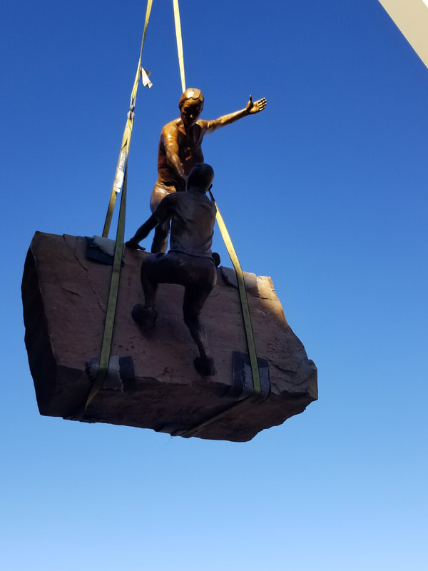 "Update 11/20/2018: We were downtown completing the installation this afternoon.  ​The bronze is in! ""Reaching Our Goal"" by Denny Haskew and the National Sculptors' Guild is the final element to go in of The Rotary Club of Thompson Valley's Legacy Project at The Foundry  ​​ The Legacy Project is the National Sculptors' Guild's 500th Public Art Placement!  We are so excited to be celebrating this moment in Loveland, Colorado where we've been headquartered since 1992.  ​We have donated our portion of the project back to the placement to give back to the community that has supported us through the years.   #FullCircle #ReachingOurGoal"
