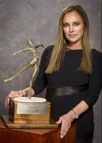 The Peggy Fleming Trophy is awarded for excellence in artistic skating and is presented by Peggy Fleming Jenkins and the Broadmoor Skating Club